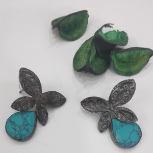 Black butterfly with turquoise stone