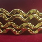 Wave design gold plated bangles. Set of 4 Pcs.