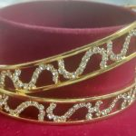 Elegant gold plated bangles with AD. Set of 2 Pcs.