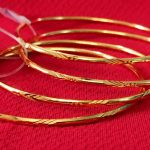 Cut design gold plated bangles. Set of 4 Pcs