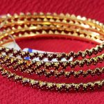 Elegant gold plated bangles. Set of 4 Pcs.